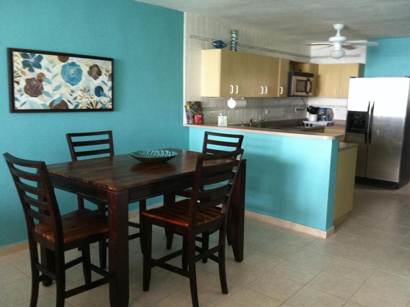 Dining & Kitchen Area - Rooftop Terrace! 2 Bedroom Condo On Luquillo Beach - Luquillo - rentals