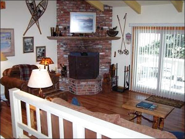 Living Room with a Fireplace and Access to the Deck - Incline Village Townhome - Exclusive Community (1065) - Lake Tahoe - rentals