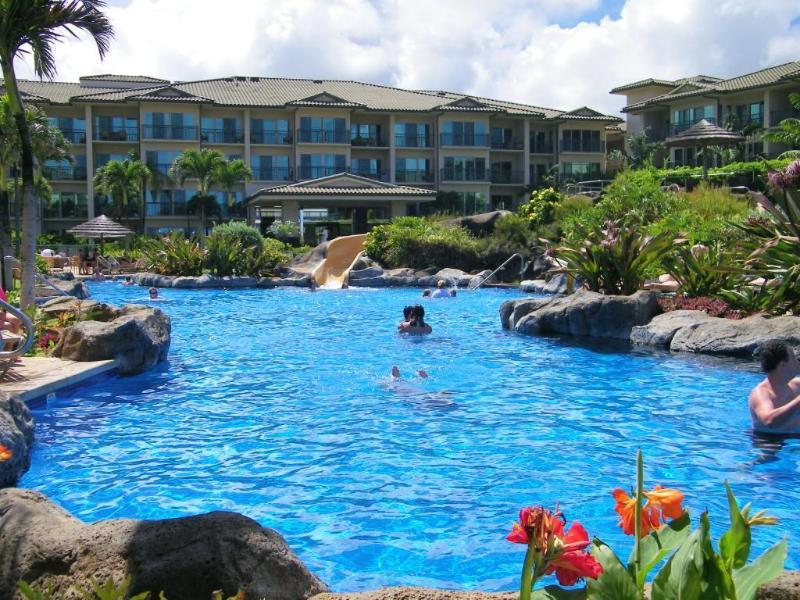 Enjoy the 2 acre heated Fantasy pool with slides, waterfalls, caves. sand bottom wading pool & spas  - Waipouli Beach Resort's First-Class Luxury F203 - Kapaa - rentals