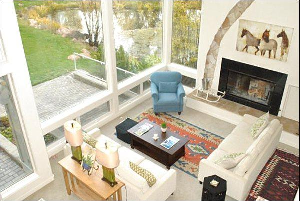 Floor to Ceiling Windows and a Fireplace in the Living Room - Stately & Roomy Vacation Home - Mountain & Golf Course Views (1150) - Ketchum - rentals