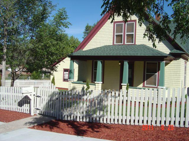 Victorian home with large front porch. - Victorian Jewel Downtown w/Garage - Mountain Views - Colorado Springs - rentals