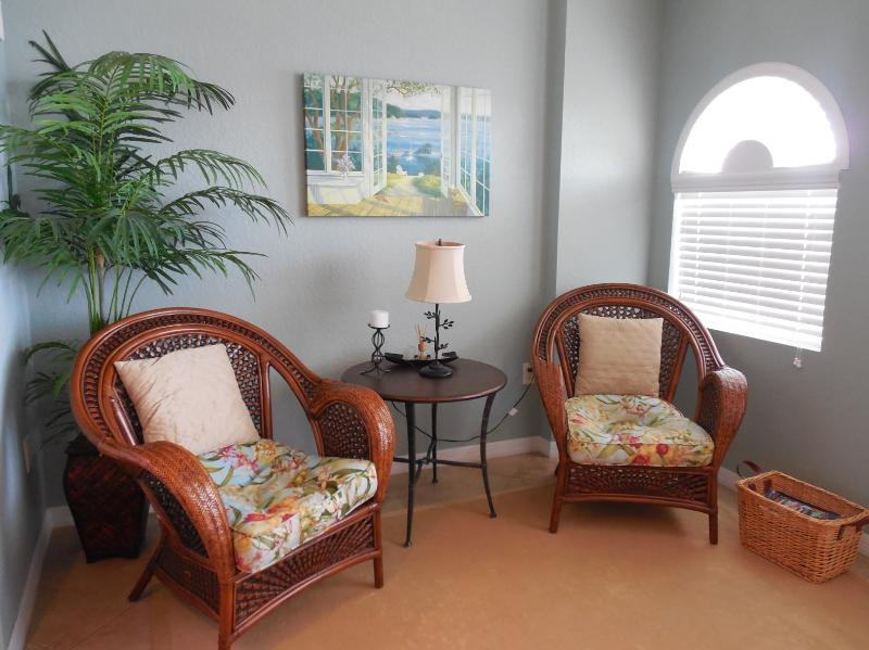 Comfortable seating area. Open the window, feel the breeze and watch the dolphins! - Dockside Condo 405, Designer styled vacation life - Clearwater Beach - rentals