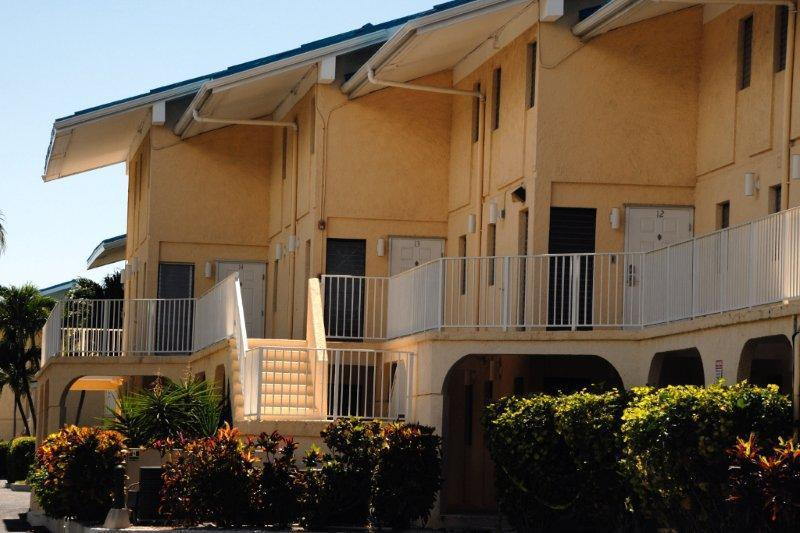 Front Entrance from Parking Lot - Cayman Reef Resort 12 - Low Cost 3 Bedroom - Seven Mile Beach - rentals