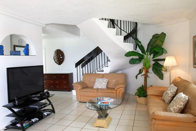 Living Room with Entertainmen Center - Cayman Reef Resort 29 - Ocean Front Resort - Seven Mile Beach - rentals