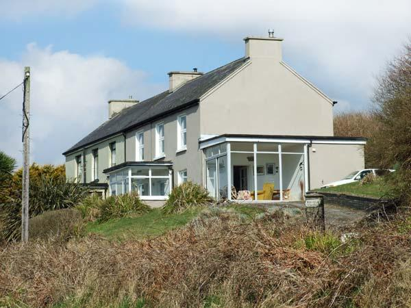 ROSEMOUNT HOUSE, multi-fuel stove, pet-friendly, patio, sea views, close beach, in Guileen Ref 22046 - Image 1 - Trabolgan - rentals