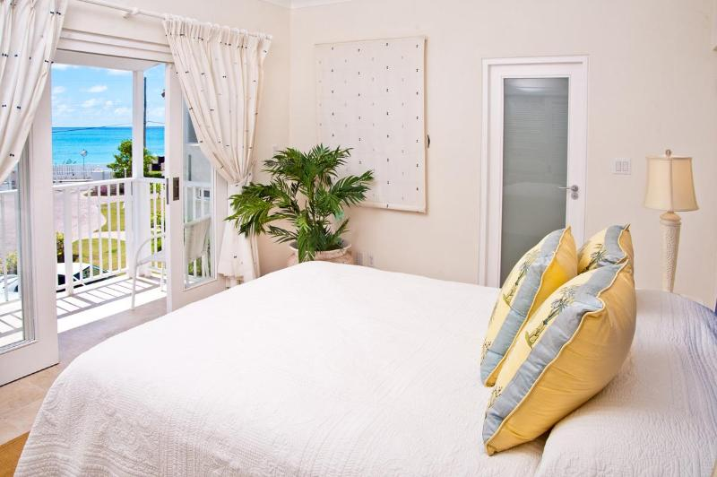 Bedroom with fabulous view  - Palisades 6A: Modern and Comfortable - Christ Church - rentals