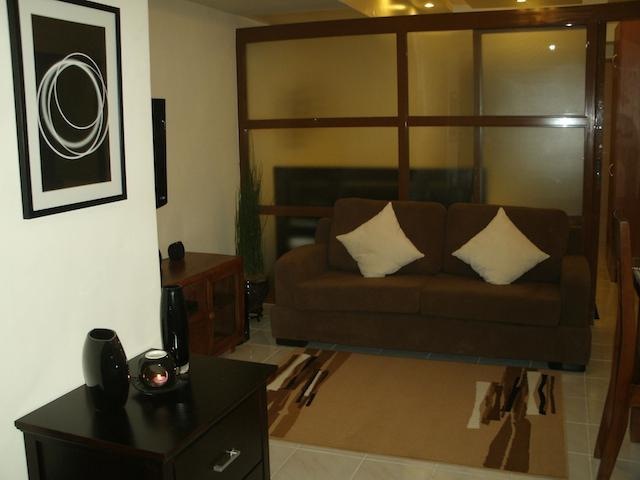 Living Room - Makati Beautifully Furnished 1 Bedroom Condo - Makati - rentals