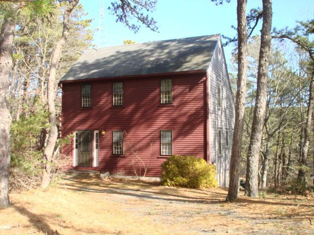 Facing the road, behind all woods - Pond access thru the woods, yet close to down town - Wellfleet - rentals