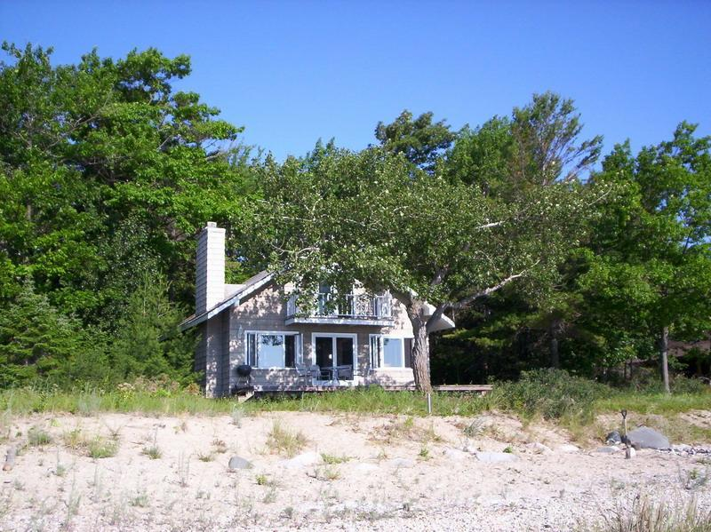 The cottage is about 40 ft. from the water. - Tranquil Haven on a Private Lake Michigan Beach - Northport - rentals