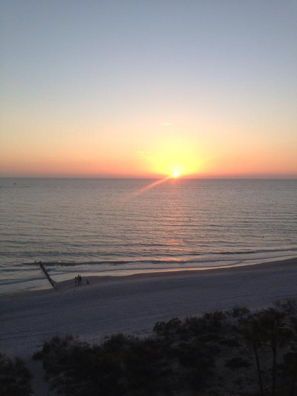 Sunset view from our Balcony - Stunning Beach front Condo on wide open beach - Madeira Beach - rentals
