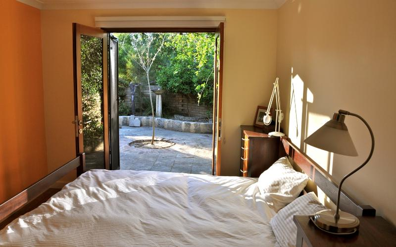 bedroom with access to front court yard - Stylish executive villa in North Fremantle. - Swansea - rentals