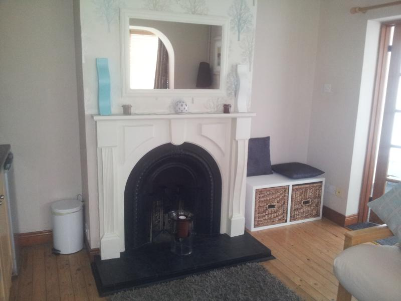 view of fire place in open plan lounge/dining - The Garden Rooms Portrush, luxury Holiday Apart. - Portrush - rentals