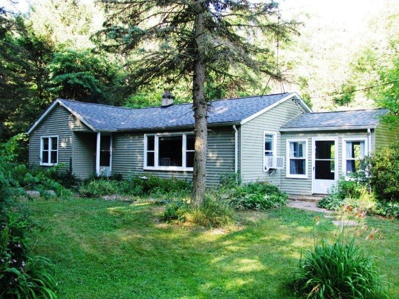Front of house - Dune Cottage, walk to beach, nestled in the shadows of a Lake Michigan dune - South Haven - rentals