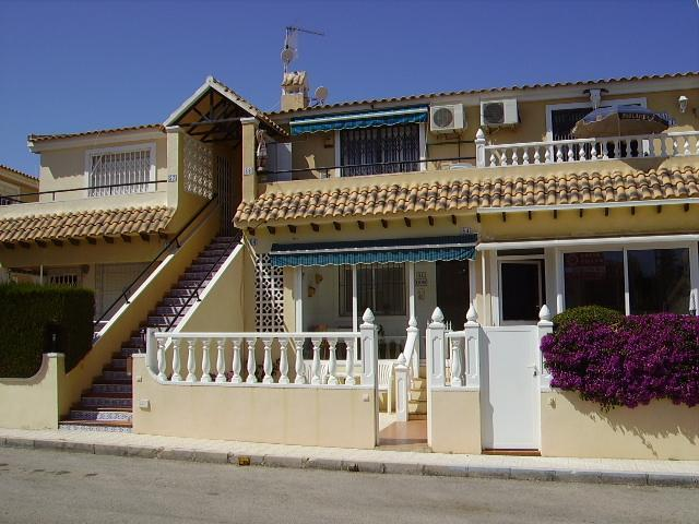 Property view with blue awning - 2 Bed, ground floor attached home in Villamartin. - Orihuela - rentals
