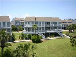 view of the courtyard from the deck - Beach Time in Barrier Dunes. Pet friendly! - Cape San Blas - rentals