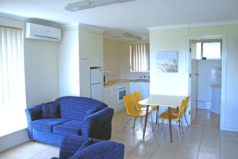 Living area, dining table, kitchen and bathroom - 2 Bedroom Self-contained Ground Floor Apartment - Robe - rentals