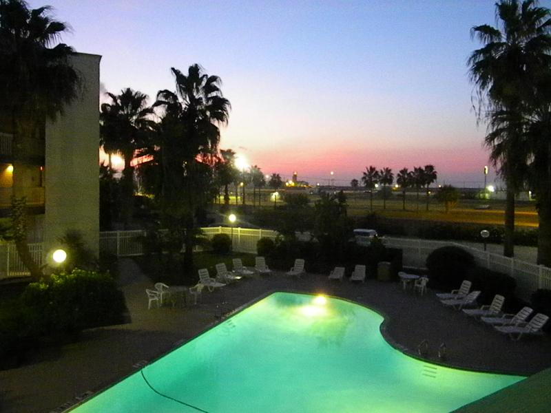 Swimming Pool - View from front door at Sunset - North Beach Family Condo - Corpus Christi - rentals