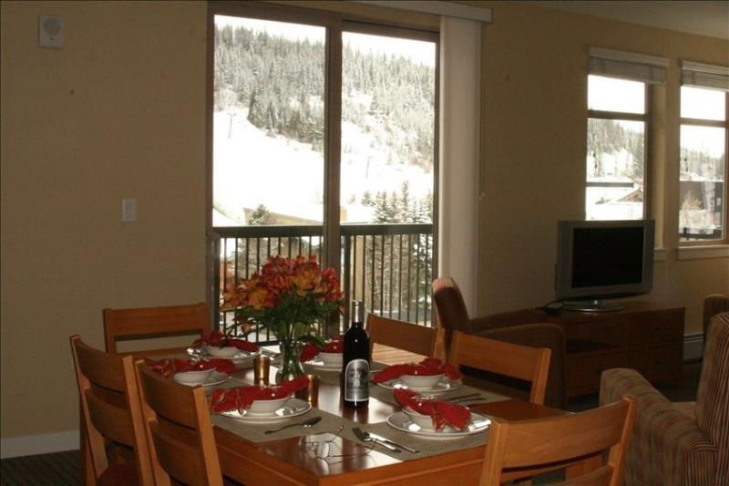 Dining room with slope views like no other unit. - Fraser Crossing Premium Mountain View 2B/2B w/deck - Winter Park - rentals