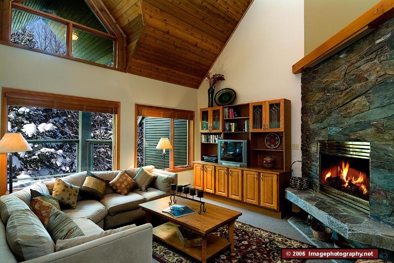 Sunken seating area with wood-burning fireplace - True ski-in, ski-out townhome with private hot tub - Whistler - rentals