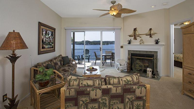 Great Living Room With Fireplace Overlooking the Lake - Harbour Towne E-103 - Stunning Corner Unit Condo with 7.5 mile Lake Views! 1.5 MM Osage Main Channel - Lake Ozark - rentals