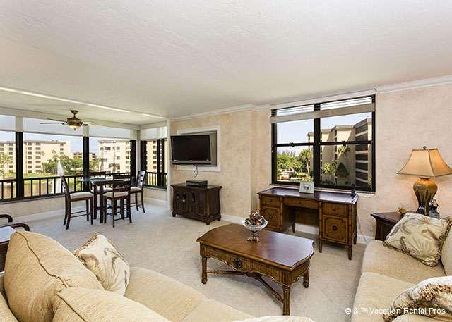 Relax in this beautifully furnished living room with LCD TV - Gulf and Bay Club 409B Beach Front - Siesta Key - rentals