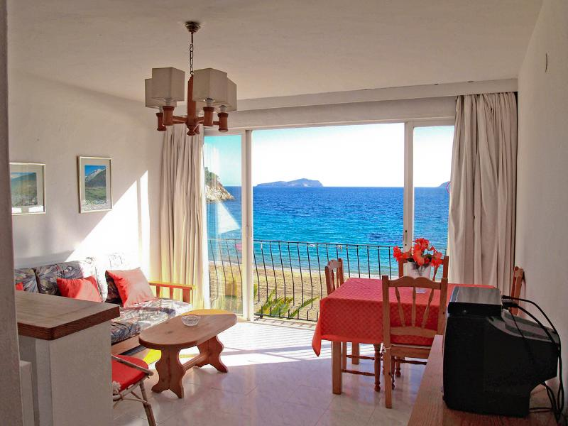 Livingroom with 180° first line beach views - Ibiza apartment AT the beach. What do you need more? - Ibiza - rentals
