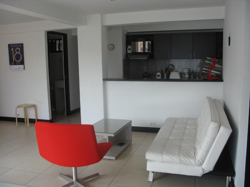 Living room and kitchen - Conveniently located in Laureles, apart 3 bedr. - Medellin - rentals