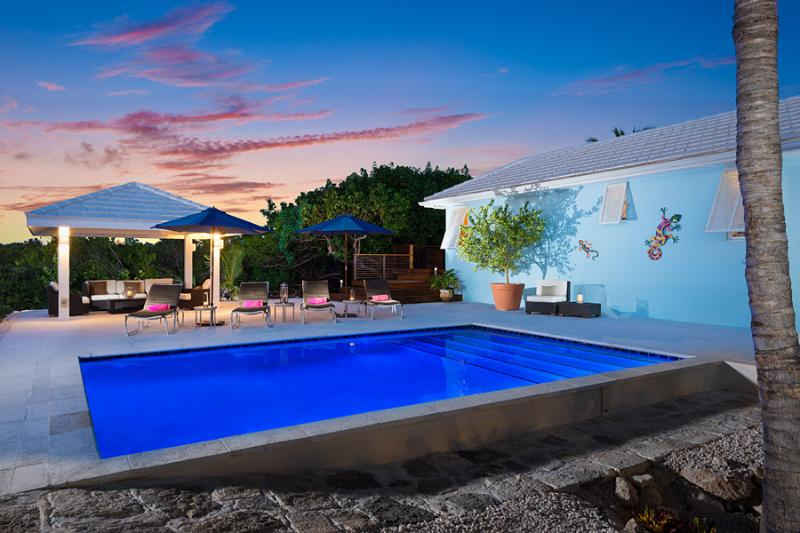 Our new pool at twilight, enjoy the light show! - FIFTY SHADES OF BLUE! A 2 minute walk to the beach - Sapodilla Bay - rentals
