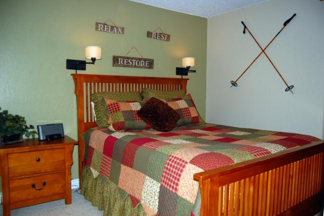 Queen bedroom with bedside lights - perfect for snuggling up with a book - 5-Star Peak 8 Ski Condo for 6; HDTV, W/D; Family - Breckenridge - rentals