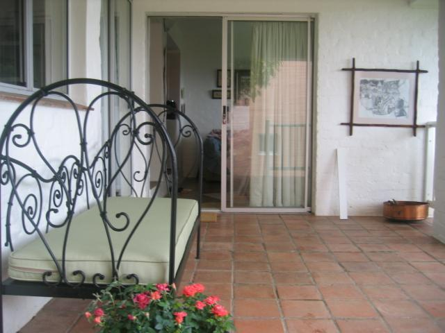 The veranda leading into the bedroom and lounge - The Doll House Garden Cottage - Knysna - rentals