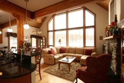 Living Room with Large leather sectional, Gas fireplace and Soaring Cathedral Ceilings - Luxury Lindal Home on the River with soaring ceilings and stunning views of Mt. Mansfield! Experience SUMMER IN STOWE!! - Stowe - rentals