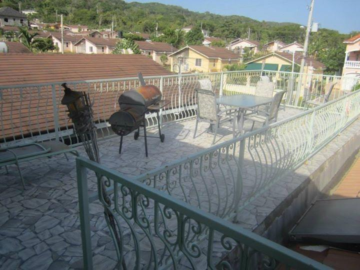 Sky patio with sitting are and grill - Luxury villa in gorgeous Jamaica. Sleeps up to 8!! - Montego Bay - rentals