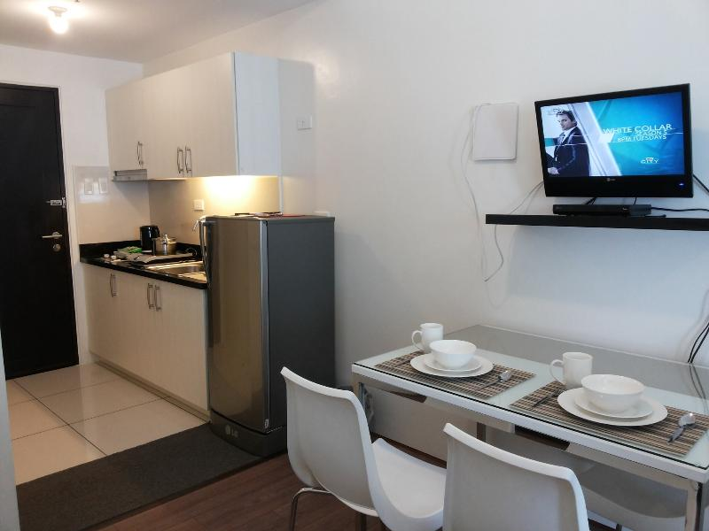 Dining and kitchenette area - Princeton Studio Beside LRT2 Gilmore - Quezon City - rentals