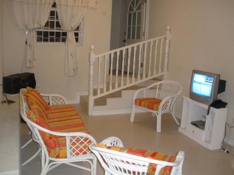 Living room area and shot of entrance door - 2 bdrm 1 bthrm apartment with ac&wifi near Oistins - Christ Church - rentals