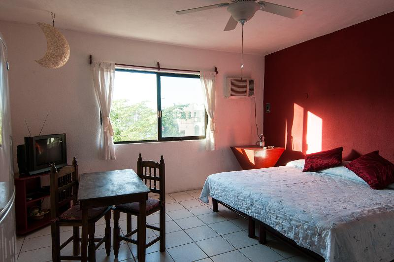 King size bed + Kitchen in Downtown Playa  redroom - Image 1 - Playa del Carmen - rentals