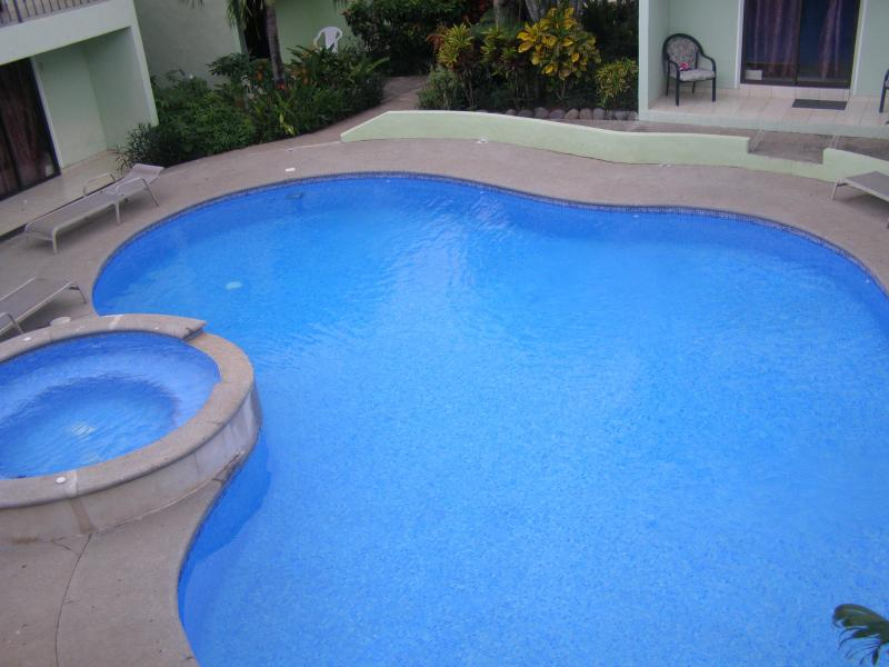 Out door pool from balcony  - Villa Riviera Condominium B1 - Playas del Coco - rentals