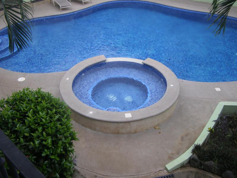 Out door pool / view  from upstairs patio  - Villa Riviera Condominium B7,Near beach /dowtown - Playas del Coco - rentals
