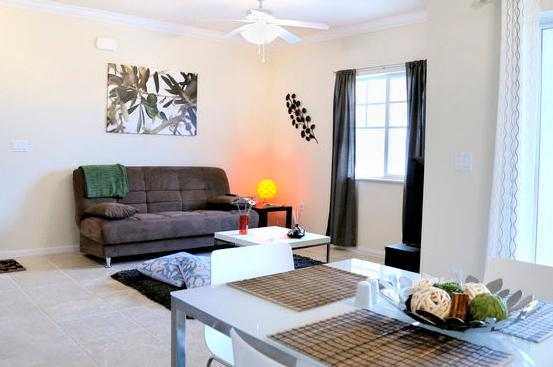 Spacious living room area with a sofa bed and Loft style dinning room - Luxurious brand new Mediterranean style condo - Fort Myers - rentals