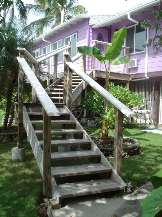 Front stairs to front door and front walkway. Note small-elevated stair steps -- easy to walk up - Elbow Cay, Abaco, Bahamas house near Tahiti beach - Hope Town - rentals