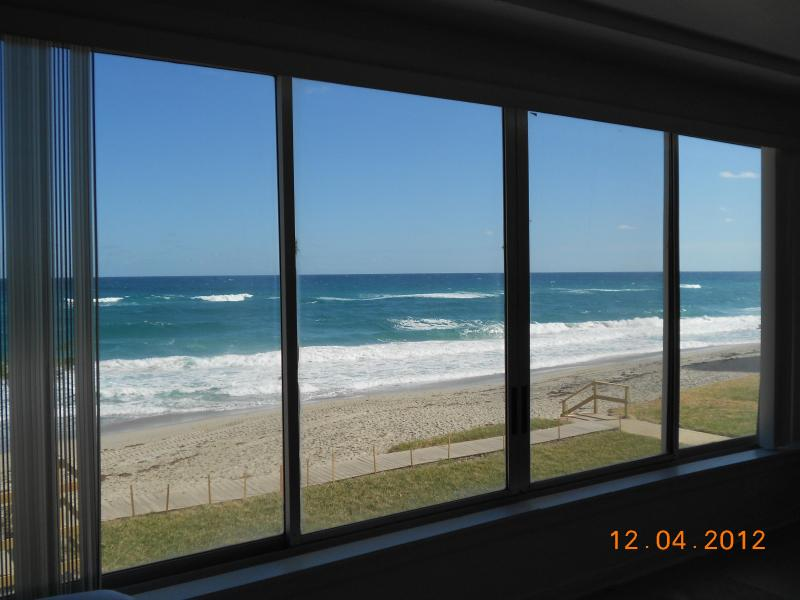 View through the 15' x 6' window. - Wall of Direct Oceanfront Studio w/2 Queen Beds - Singer Island - rentals