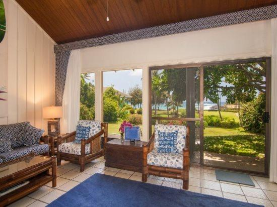 living room - Beautifully decorated ocean view condo steps from Brennecke`s Beach. Sleeps 5. Free car* with stay of 7 nights or more. - Poipu - rentals