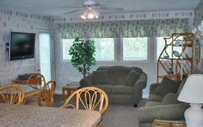 Living room with flat-screen TV and sleeper sofa - LOTS OF FUN, MB RESORT 2BR, POOL/LAZY RIVER FS4317 - Myrtle Beach - rentals