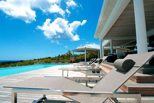 St. Martin Villa 146 This Impressive Contemporary Villa Is Nestled Into The Hillside In Terres Basses With Stunning Sunset Ocean Views. - Image 1 - Terres Basses - rentals