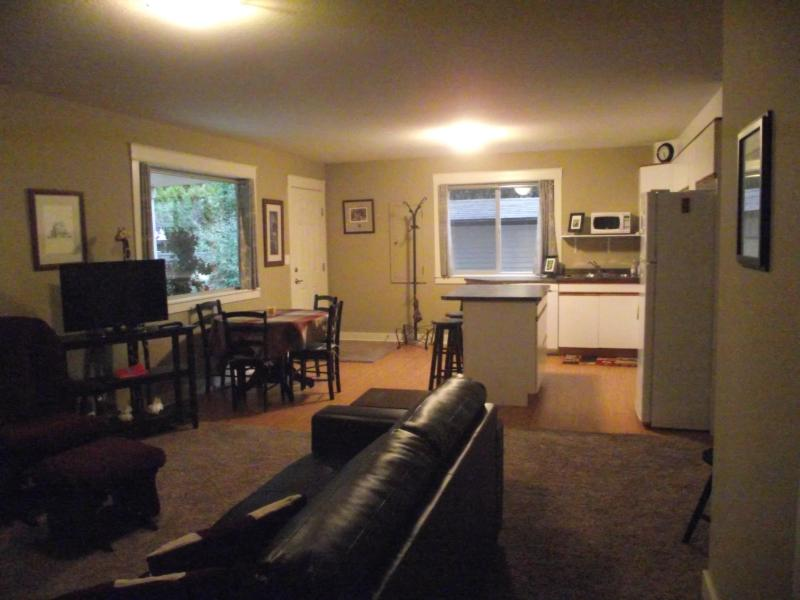 Open Concept Living/dining/kitchen with full size dishewasher, stove and fridge and Leather sofa too - Ground Level Suite Near Silver Star in Vernon BC. - Vernon - rentals