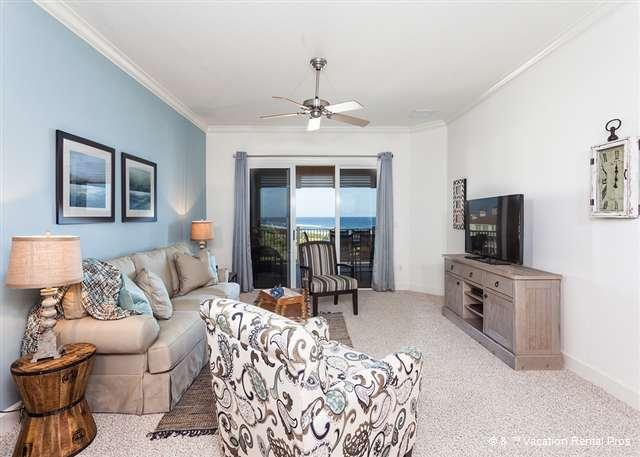 The spacious living area includes HDTV and sleeper sofa - 452 Cinnamon Beach, 5th Floor Luxury Condo, Sweeping Views, HDTV - Palm Coast - rentals