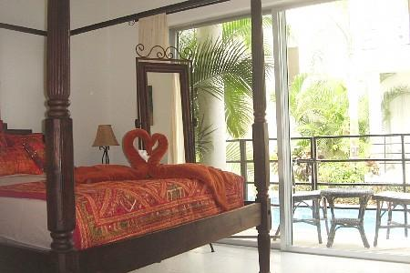 Queen Size - 4 poster bed in Master bedroom - Indonesian Hideaway - Two Bdr Condo - Playa del Carmen - rentals