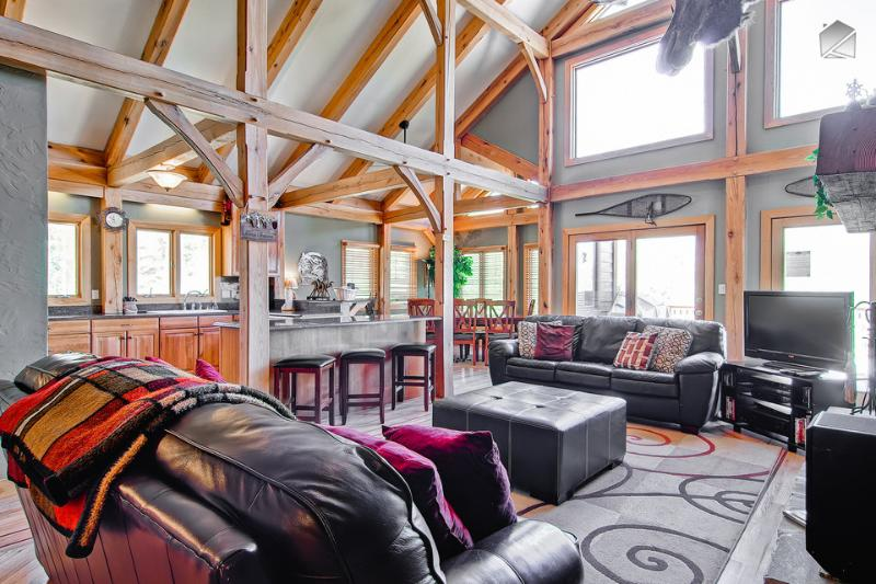 The open layout, wall of windows, and vaulted ceiling make this an inviting place to hang out. - Serene mountain home with pool table and gorgeous mountain views from the hot tub! - Snow Mountain Lodge - Breckenridge - rentals