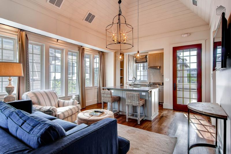 The stylish living area is compact, but open and filled with light. The sofa sleeper is perfect for two kids - Luxury Carriage House, shares private pool with Main House, near Rosemary Beach town center - New Providence Carriage House - Rosemary Beach - rentals