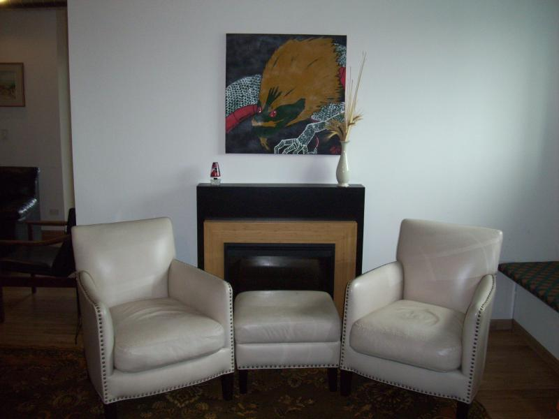 The living room is very large. This is the seating area next to the fireplace. - King Suite –  Loft Style Two Bedroom 2 baths - Chicago - rentals