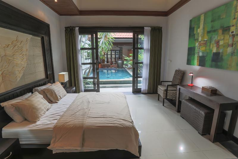 View from one bedroom over pool and living room - Luxurious, elegant , high quality villa - Seminyak - Umalas - rentals